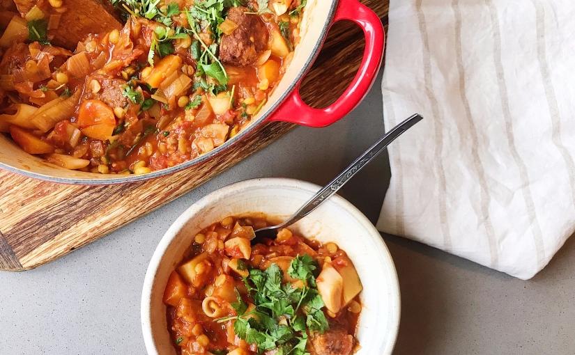 Veggie sausage, tomato, leek and potatoone-pot